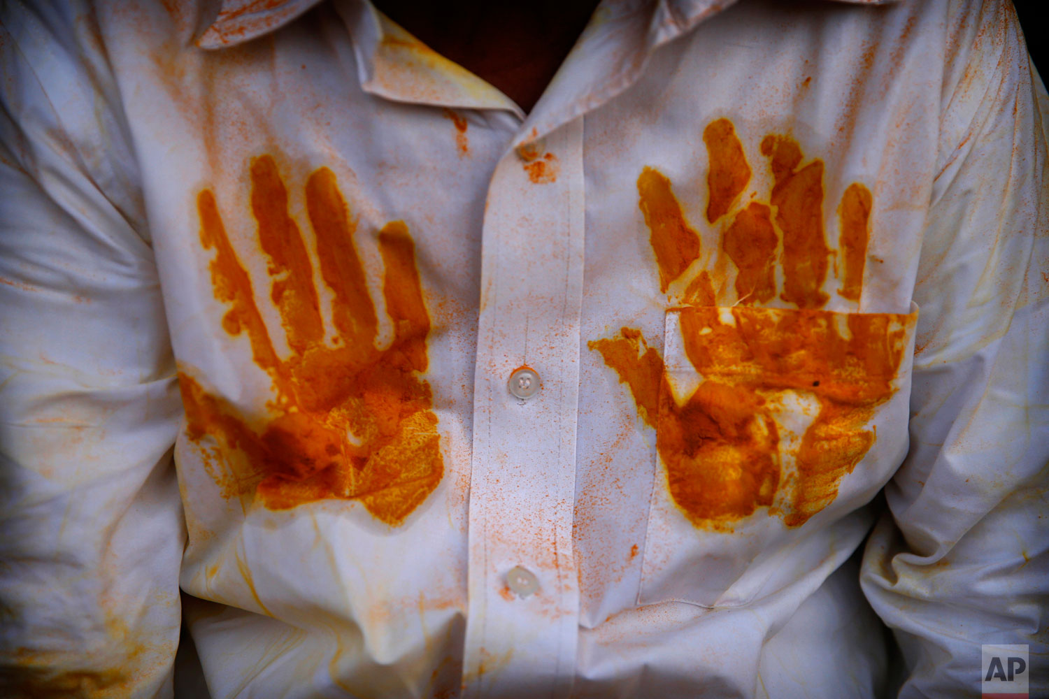 A devotee's shirt has handprints of the spice turmeric during the celebration of the Bhandara Festival, or the Festival of Turmeric, at the Jejuri temple in Pune district, Maharashtra state, India. During the festival, devotees use the golden powder to worship the deity Lord Khandoba, widely known as a descendant of the sun, and to celebrate his victory over the demons Mani and Malla. (AP Photo/Rafiq Maqbool)