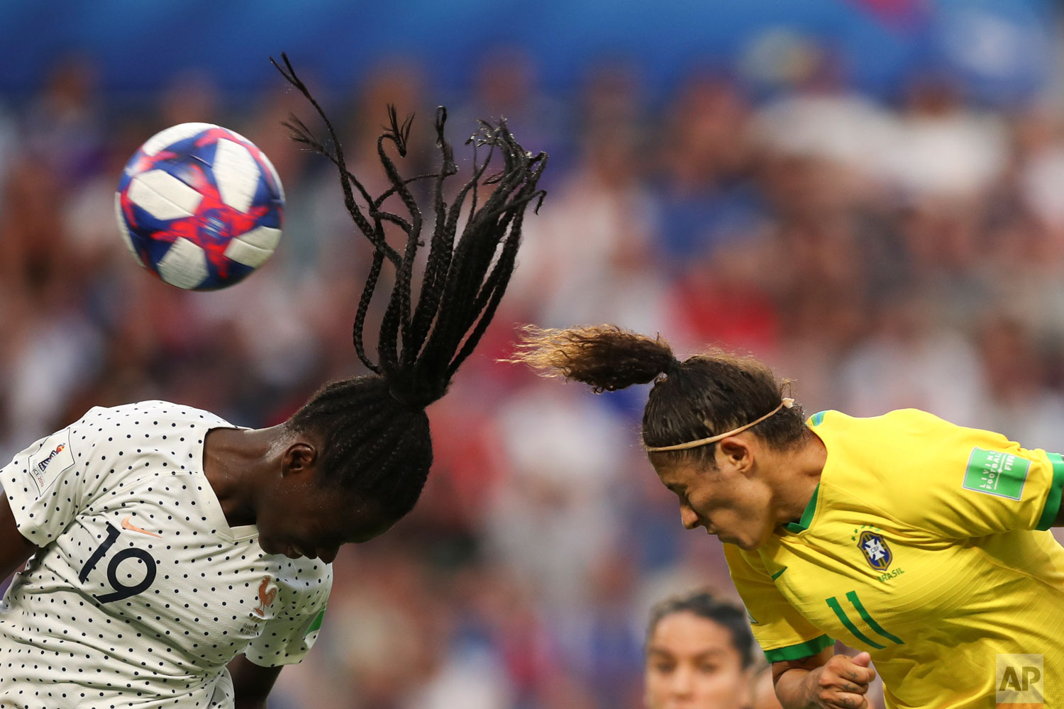 France's Griedge Mbock Bathy, left, and Brazil's Cristiane go for a header during the Women's World Cup round of 16 soccer match between France and Brazil at the Oceane stadium in Le Havre, France, Sunday, June 23, 2019. (AP Photo/Francisco Seco)