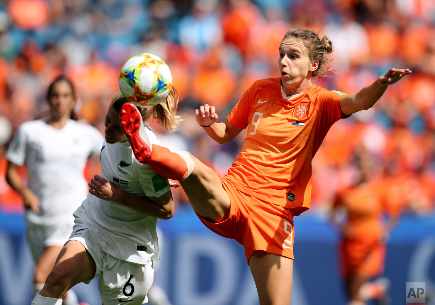 Netherlands' Vivianne Miedemam, right, kicks the ball challenged by New Zealand's Rebekah Stott during the Women's World Cup Group E soccer match between New Zealand and the Netherlands in Le Havre, France, Tuesday, June 11, 2019. (AP Photo/Francisco Seco)