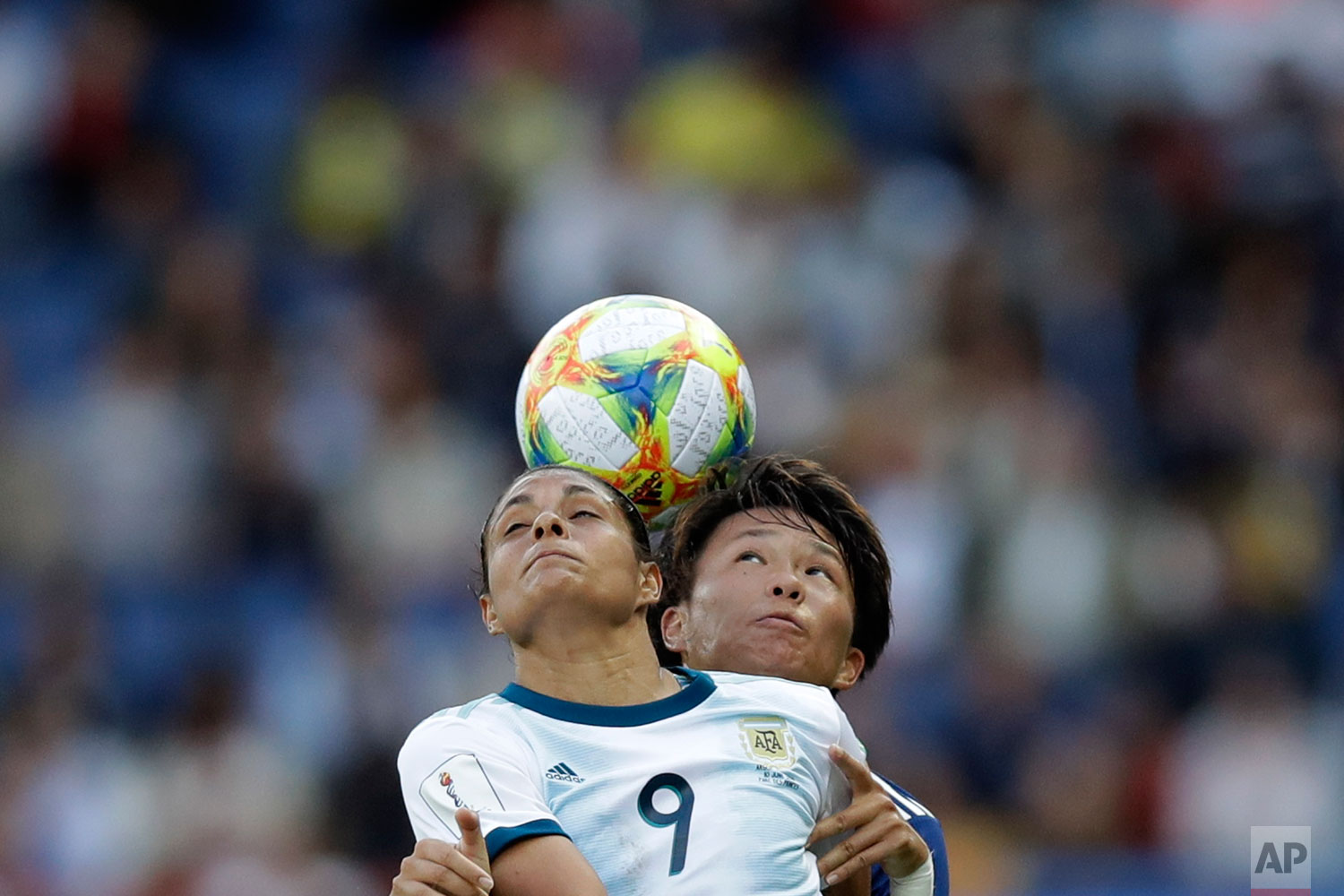 Argentina's Sole Jaimes, left, fights for a high ball with Japan's Moeka Minami during the Women's World Cup Group D soccer match between Argentina and Japan at the Parc des Princes in Paris, Monday, June 10, 2019. (AP Photo/Alessandra Tarantino)