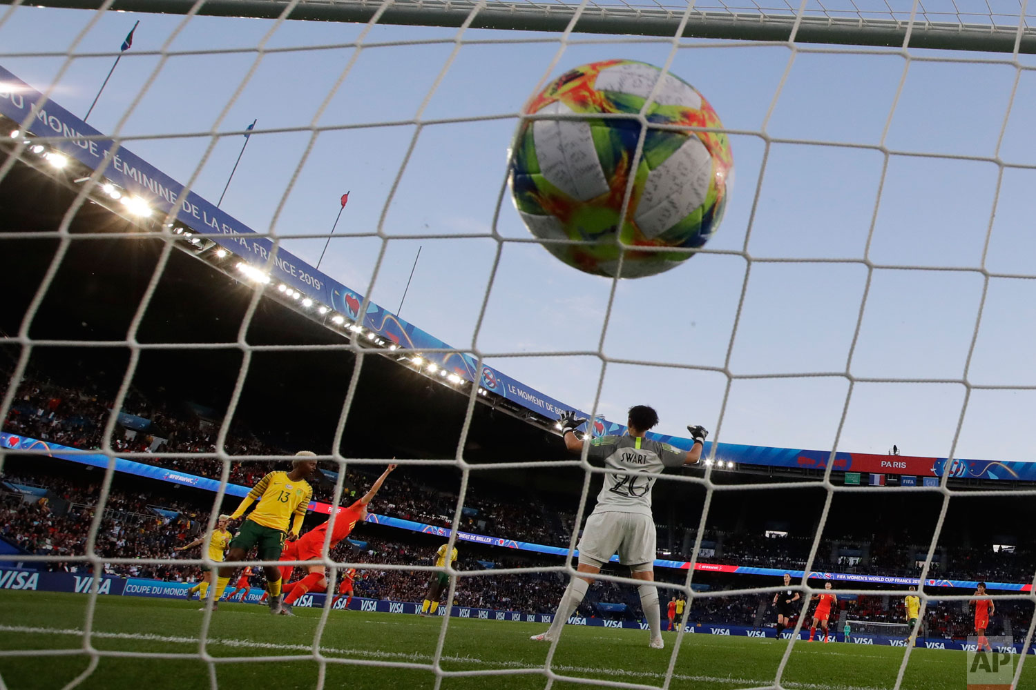 China's Li Ying, second left, celebrates after scoring the opening goal past South Africa goalkeeper Kaylin Swart, right, during the Women's World Cup Group B soccer match between China and South Africa at Parc des Princes in Paris, France, Thursday, June 13, 2019. (AP Photo/Alessandra Tarantino)