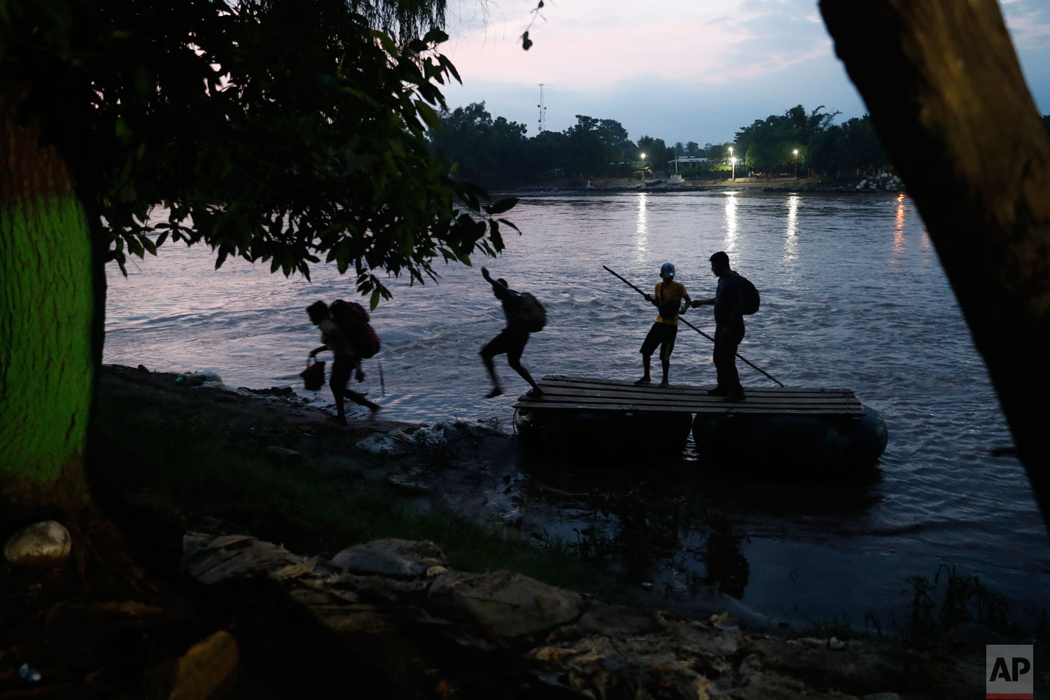 Migrants on rafts reach the Mexico shore after crossing the Suchiate river on the Guatemala – Mexico border, near Ciudad Hidalgo, Mexico, Wednesday, June 5, 2019. (AP Photo/Marco Ugarte)