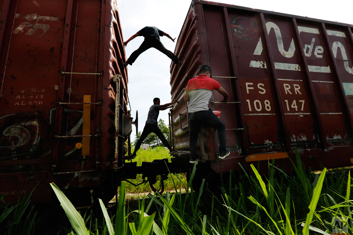 Honduran migrants ride a freight train on their way north, in Salto del Agua, Chiapas state, Mexico, Tuesday, June 25, 2019.  (AP Photo/Marco Ugarte)