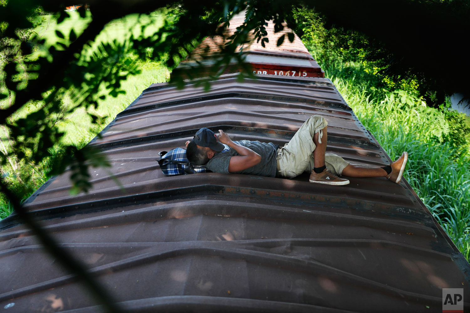A Honduran migrant ride a freight train on their way north, in Salto del Agua, Chiapas state, Mexico, Tuesday, June 25, 2019.  (AP Photo/Marco Ugarte)