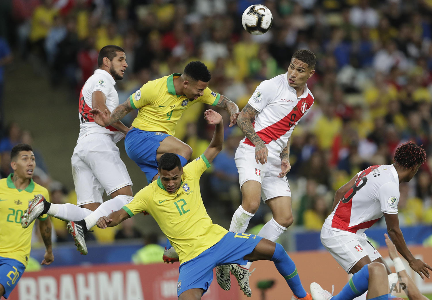 Brazil's Gabriel Jesus, center left, goes for a header with Peru's Paolo Guerrero, center right, during the final match of the Copa America at Maracana stadium in Rio de Janeiro, Brazil, Sunday, July 7, 2019.  Brazil defeated Peru 3-1 and became the Copa America champion. (AP Photo/Silvia Izquierdo)