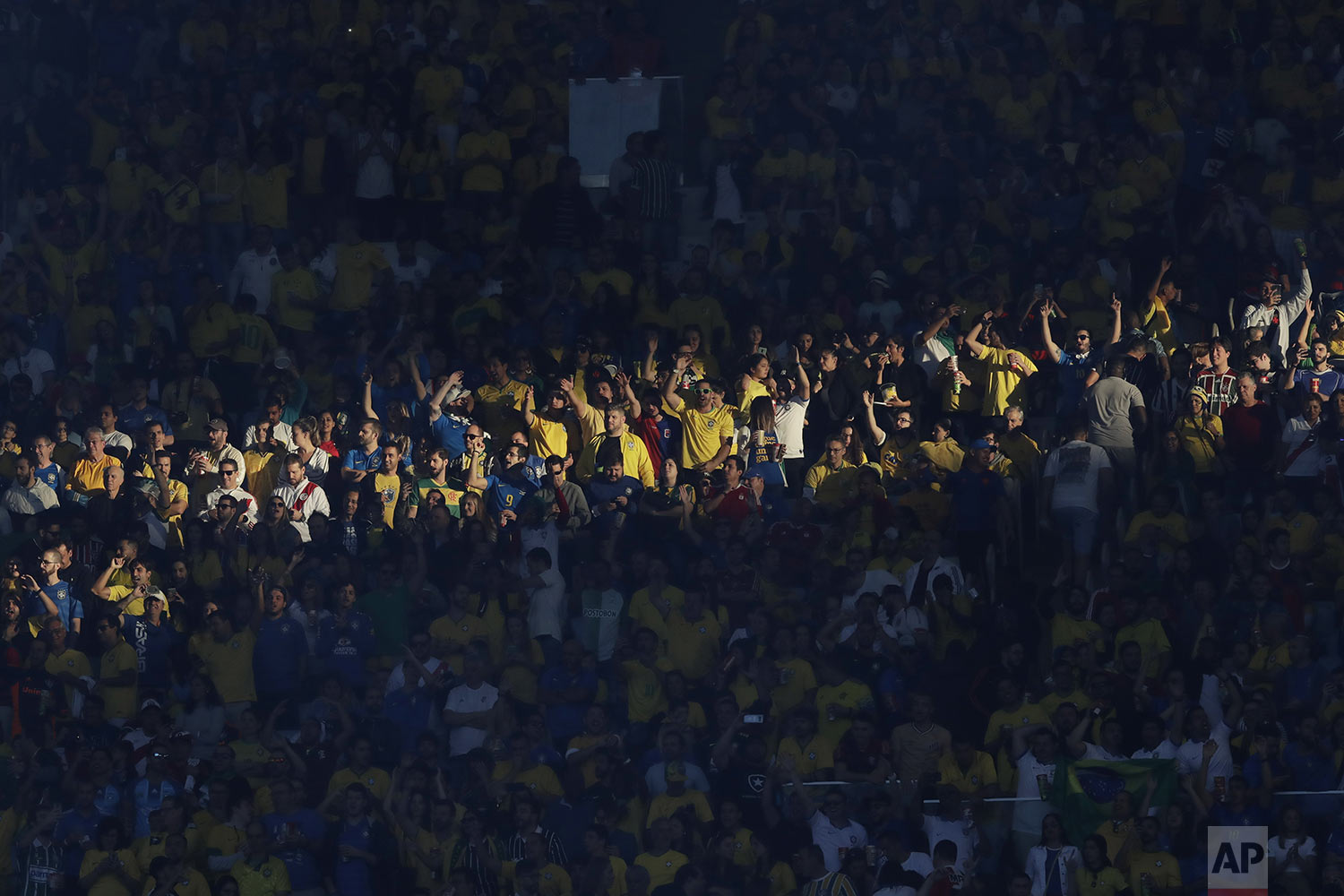 Brazil's fans cheer prior to the final match of the Copa America against Peru at Maracana stadium in Rio de Janeiro, Brazil, Sunday, July 7, 2019. (AP Photo/Andre Penner)
