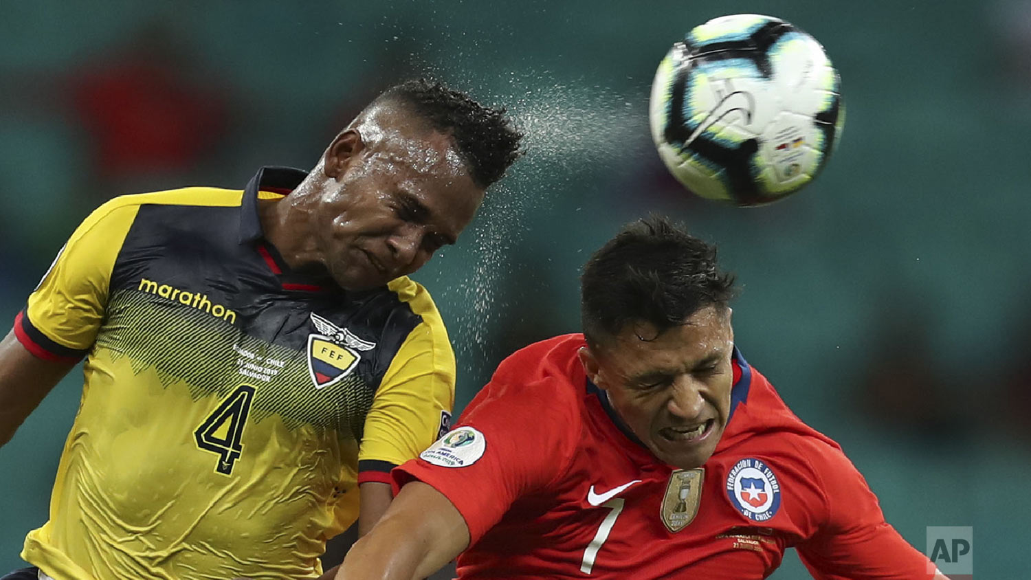 Ecuador's Pedro Velasco, left, and Chile's Alexis Sanchez go for a header during a Copa America Group C soccer match at  Arena Fonte Nova in Salvador , Brazil, Friday, June 21, 2019. (AP Photo/Natacha Pisarenko)
