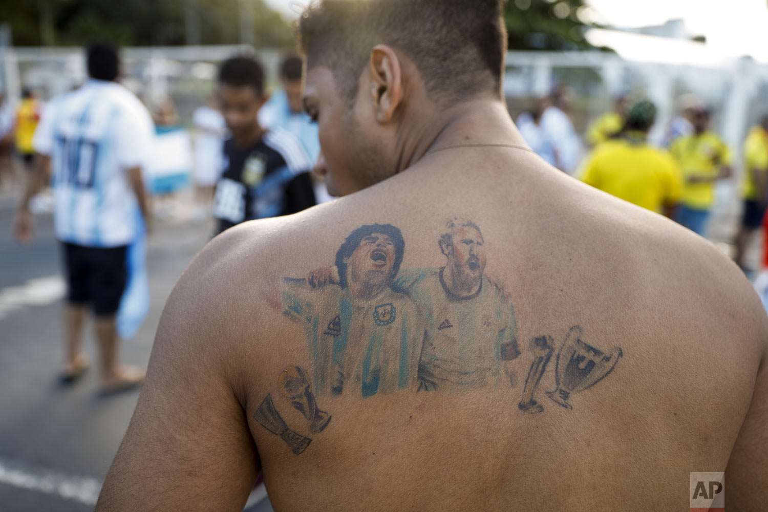 A fan of Argentina shows off his tattoo of soccer star Diego Maradona and Lionel Messi outside Arena Fonte Nova prior to a Copa America Group B soccer match between Colombia and Argentina in Salvador, Brazil, Saturday, June 15, 2019. (AP Photo/Natacha Pisarenko)