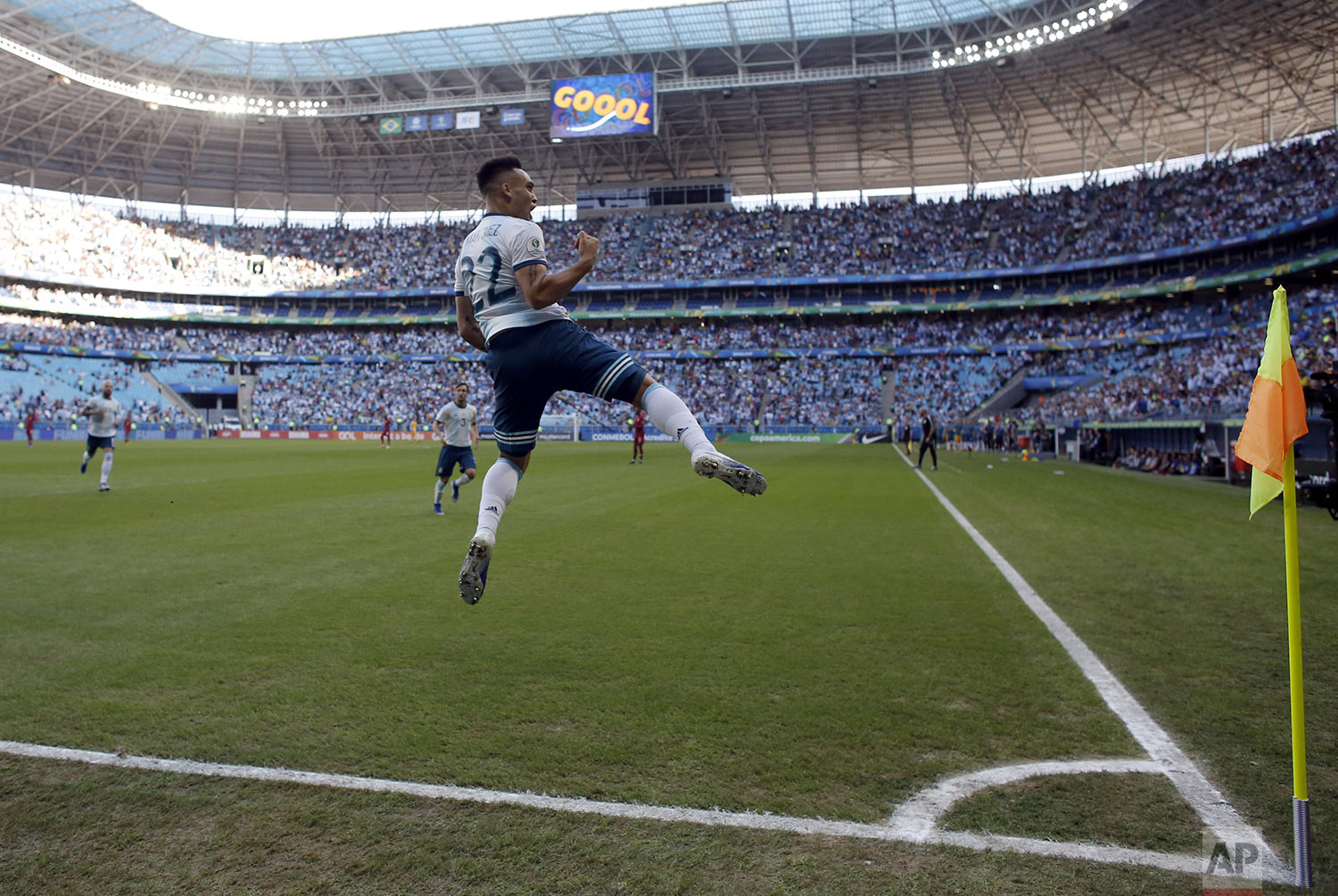 Argentina's Lautaro Martinez celebrates scoring against Qatar during a Copa America Group B soccer match at Arena do Gremio in Porto Alegre, Brazil, Sunday, June 23, 2019. (AP Photo/Victor Caivano)
