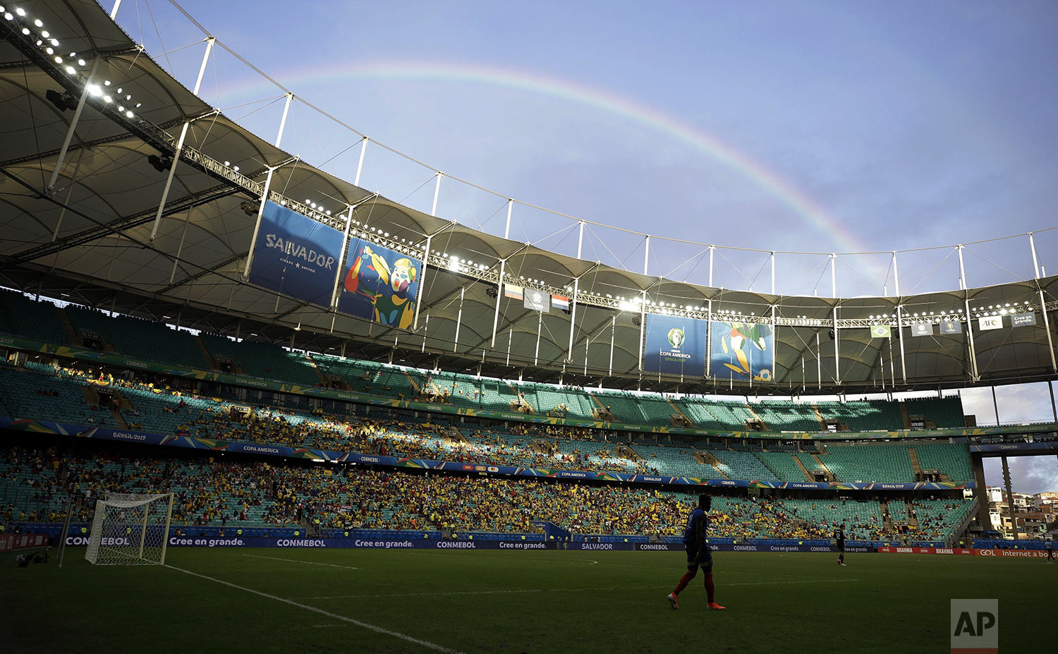 A rainbow appears in the sky at the end of the first half of a Copa America Group B soccer match between Colombia and Paraguay at Arena Fonte Nova in Salvador, Brazil, Sunday, June 23, 2019. Colombia beat Paraguay 1-0 Sunday with a second-string team to stay perfect at the Copa America with three wins and without conceding any goals. (AP Photo/Ricardo Mazalan)