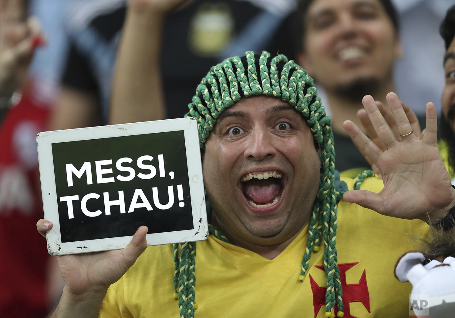 "A Brazil soccer fan shows a sign that reads ""Goodbye Messi"" at the end of a Copa America semifinal soccer match at Mineirao stadium in Belo Horizonte, Brazil, Tuesday, July 2, 2019. Brazil defeated Argentina 2-0 and advanced to the final. (AP Photo/Natacha Pisarenko)"
