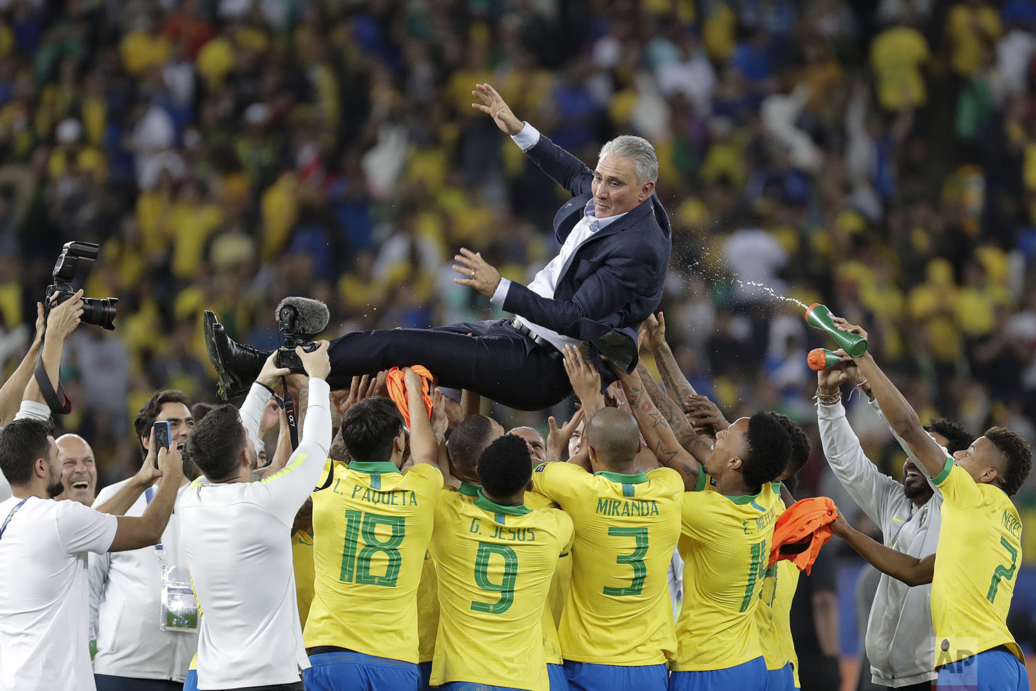 Brazil's coach Tite is thrown in the air by players to celebrate their 3-1 victory over Peru at the end of the final Copa America soccer match at Maracana stadium in Rio de Janeiro, Brazil, Sunday, July 7, 2019. (AP Photo/Leo Correa)
