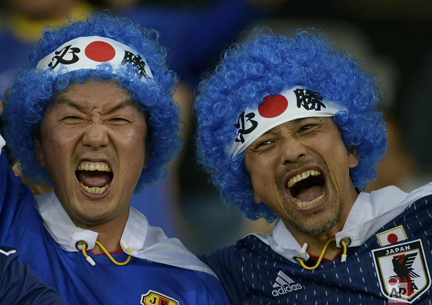 Japan soccer fans cheer prior to their team's Copa America Group C soccer match against Ecuador at Mineirao stadium in Belo Horizonte, Brazil, Monday, June 24, 2019. (AP Photo/Eugenio Savio)