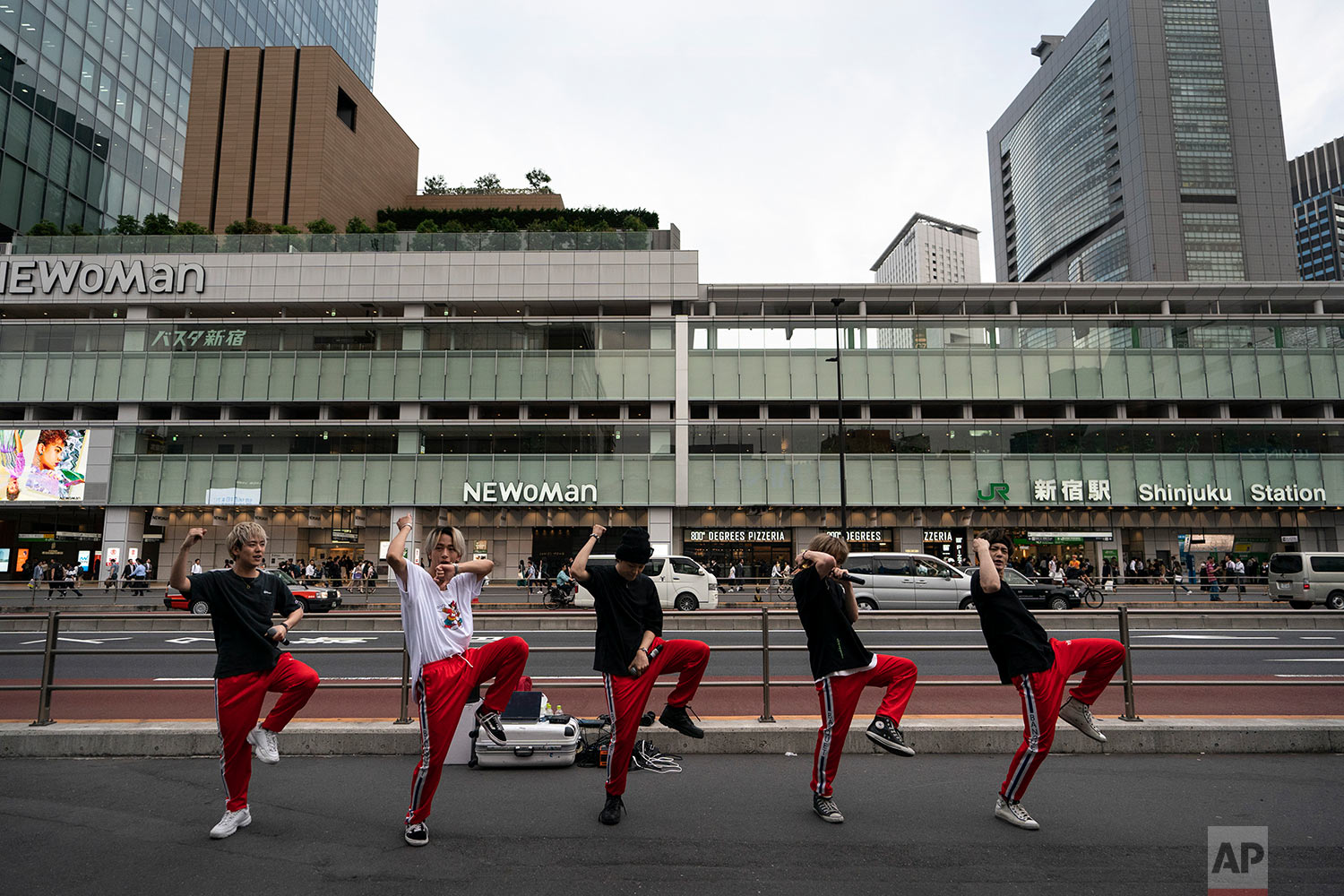 A Japanese dance and vocal group called Banquet performs on the street outside Shinjuku Station in Tokyo, June 4, 2019. (AP Photo/Jae C. Hong)