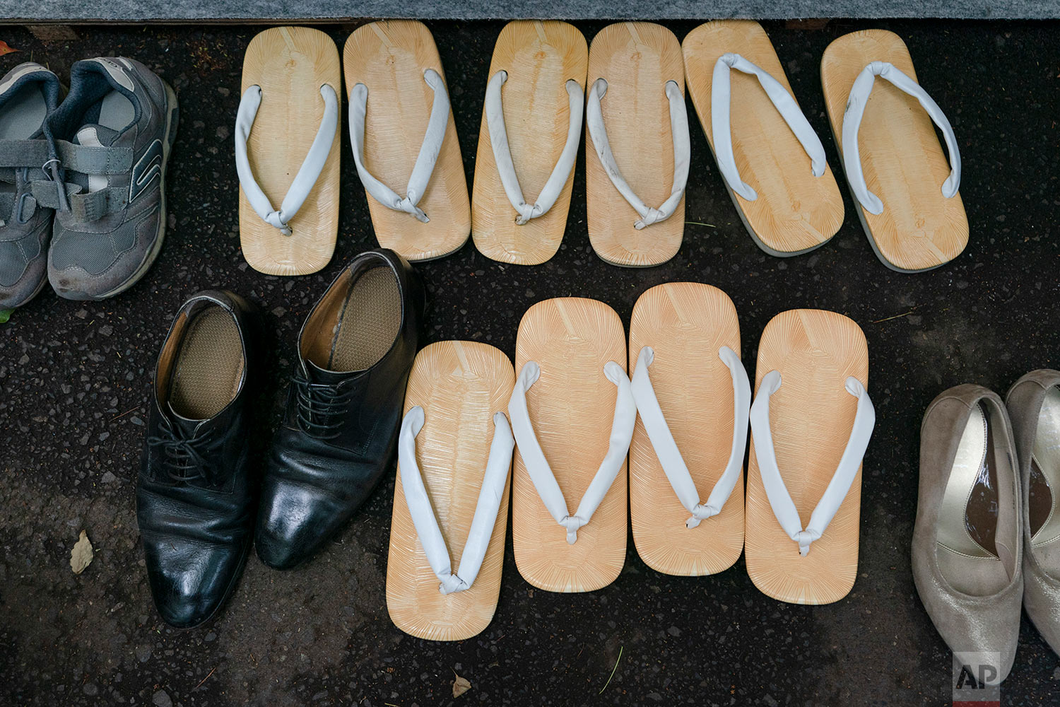 Traditional Japanese footwear called zori are seen next to sneakers and dress shoes during a kendo competition in Tokyo, June 8, 2019. (AP Photo/Jae C. Hong)