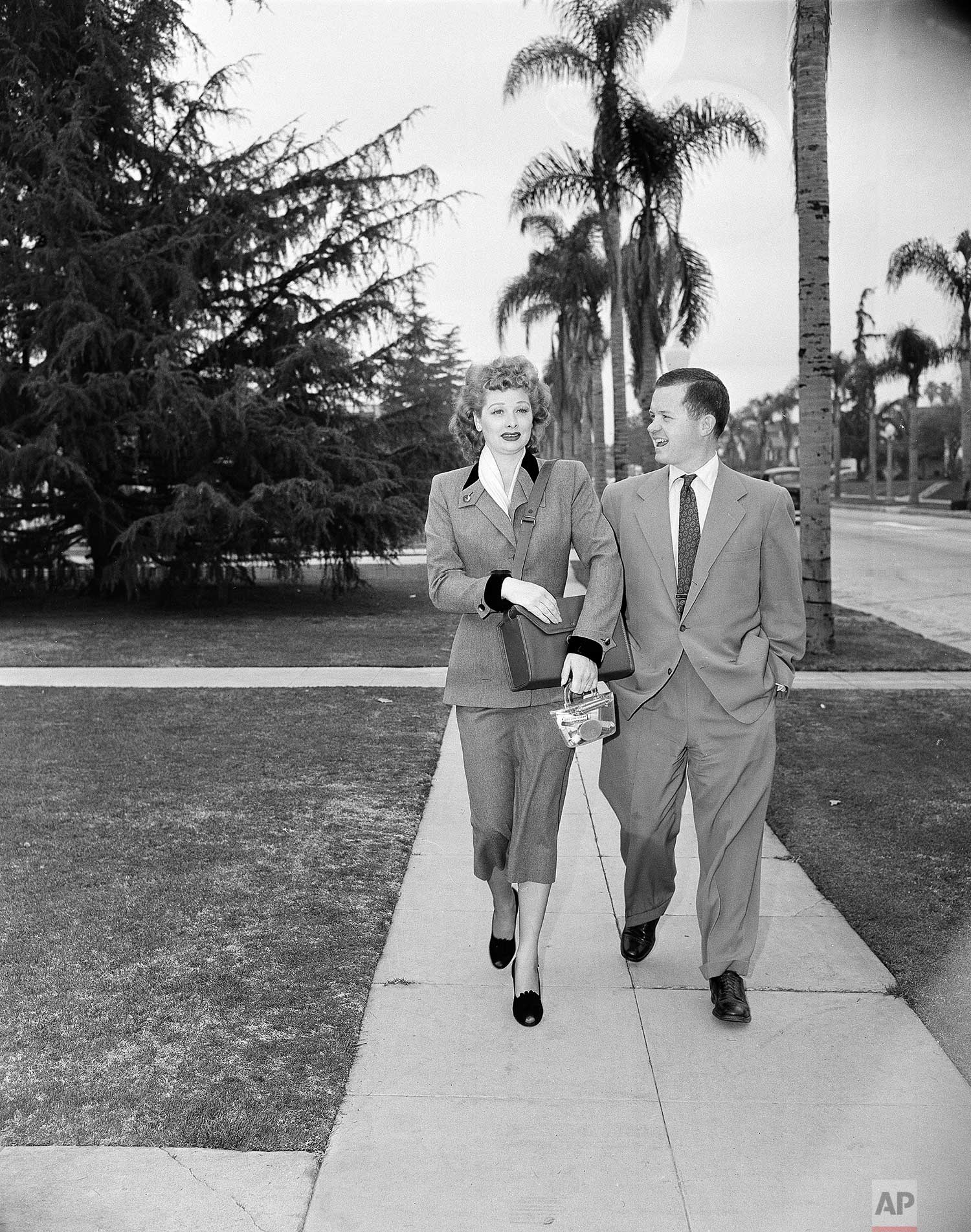 In this June 1950 photo, Associated Press reporter Bob Thomas accompanies Lucille Ball as she practices the part of a door-to-door saleswoman in  Los Angles. (AP Photo)
