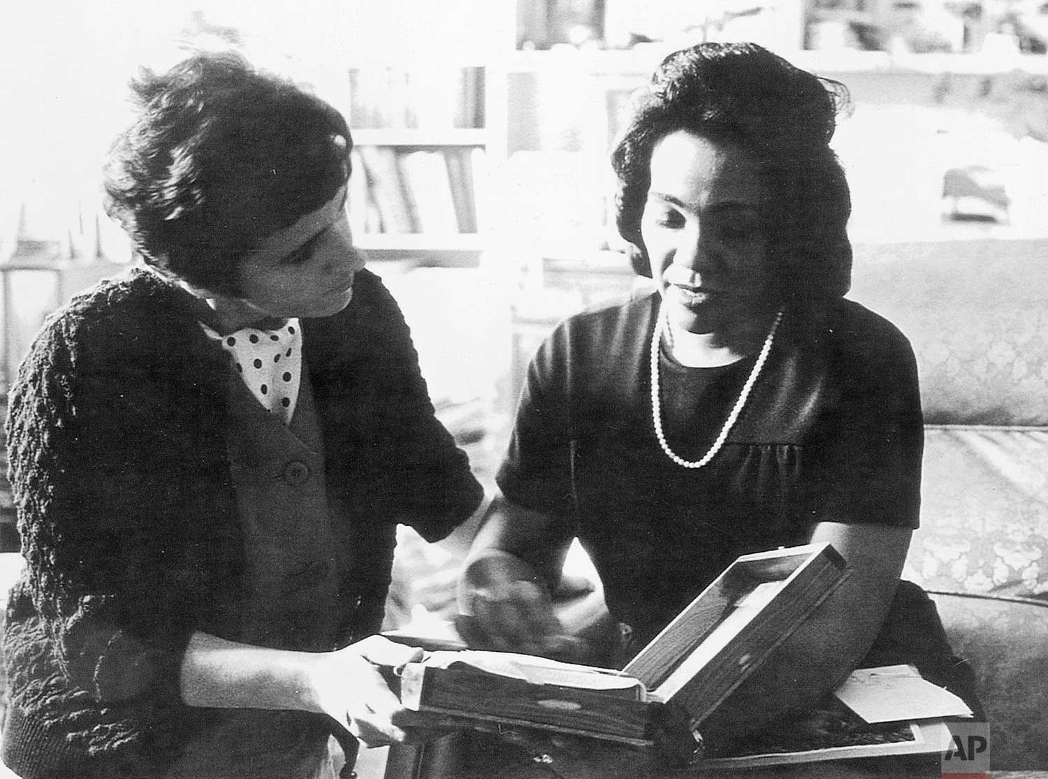 """In this 1968 photo, Coretta Scott King and AP reporter Kathryn Johnson, left, review plans for The King Center during a meeting on the campus of Atlanta University in Atlanta. In a new memoir, """"My Life with the Kings: A Reporter's Recollections of Martin, Coretta and the Civil Rights Movement,"""" retired Associated Press reporter Kathryn Johnson describes many civil rights flashpoints that she covered in the 1960s, and details her close relationship with the movement's leader, the Rev. Martin Luther King Jr., and his family. (AP Photo)"""