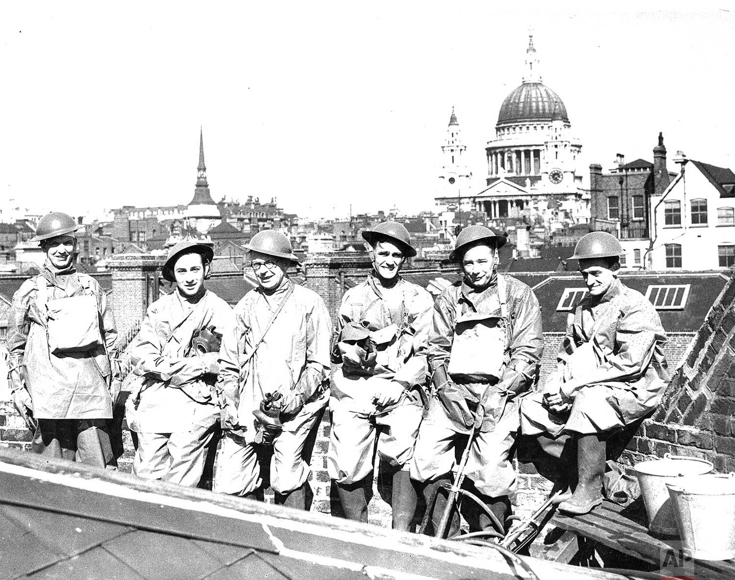 Members of the AP London staff have their own air raid protection squad and here they are shown going through their first full dress parade on May 16, 1940 on the roof of the Associated Press building. They are, left to right, I. A. Milligan, C. Michaels, K. C. Boxall, L. I. Jones, G. Selkirk and G. Angus. (AP Photo/Corporate Archives)