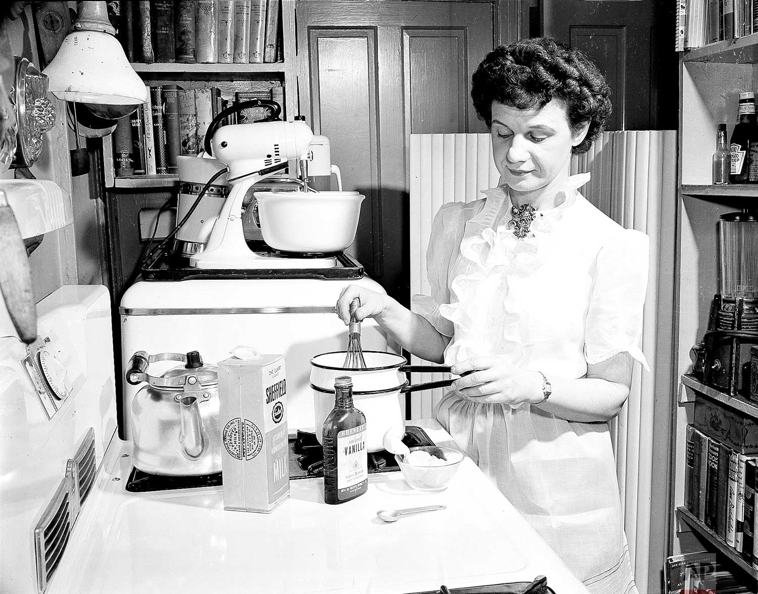 Associated Press Food Editor Cecily Brownstone in her home test kitchen in 1947. (AP Photo)