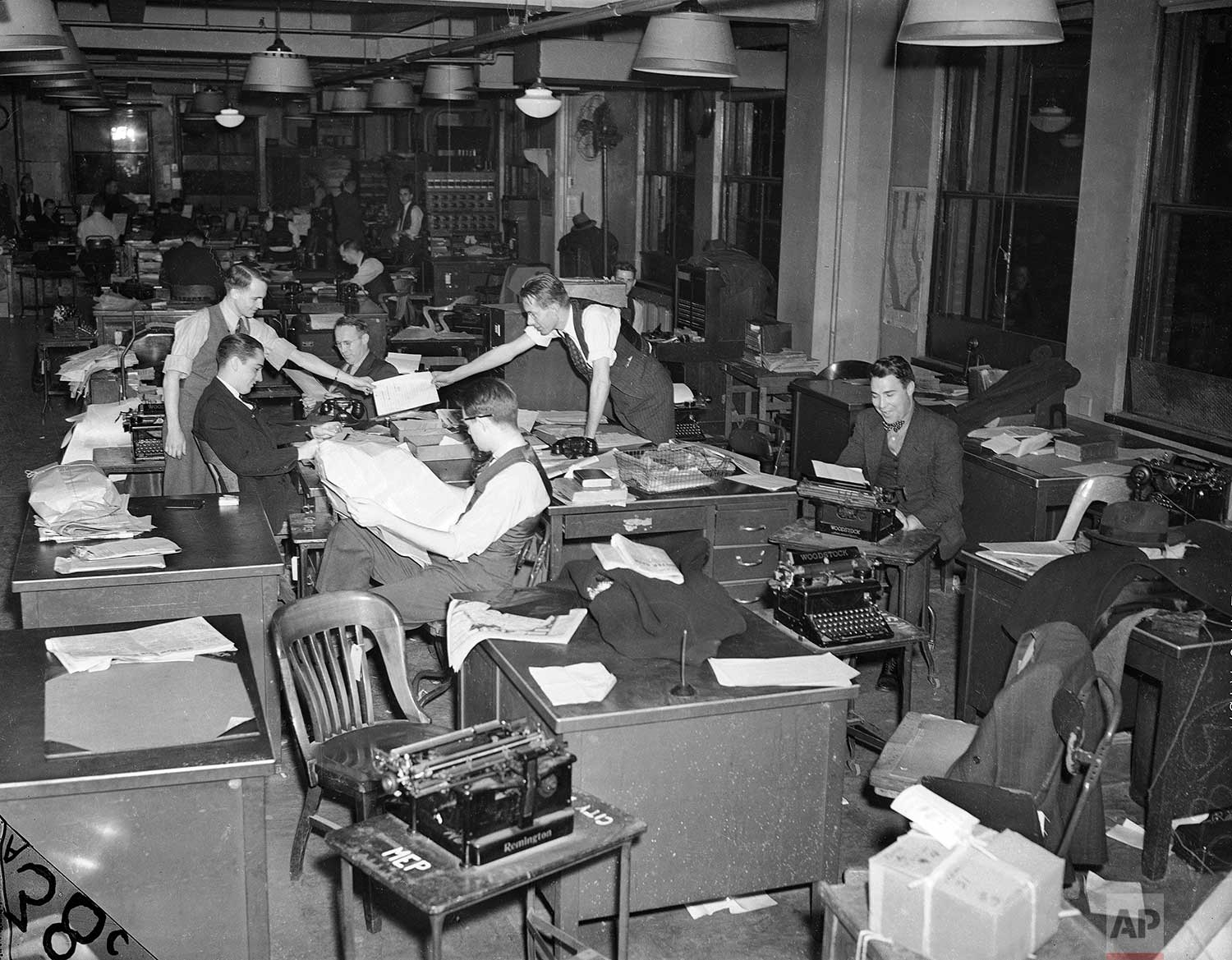 This undated photo shows reporters working at the 383 Madison Ave. office of The Associated Press in New York. (AP Photo/Corporate Archives)