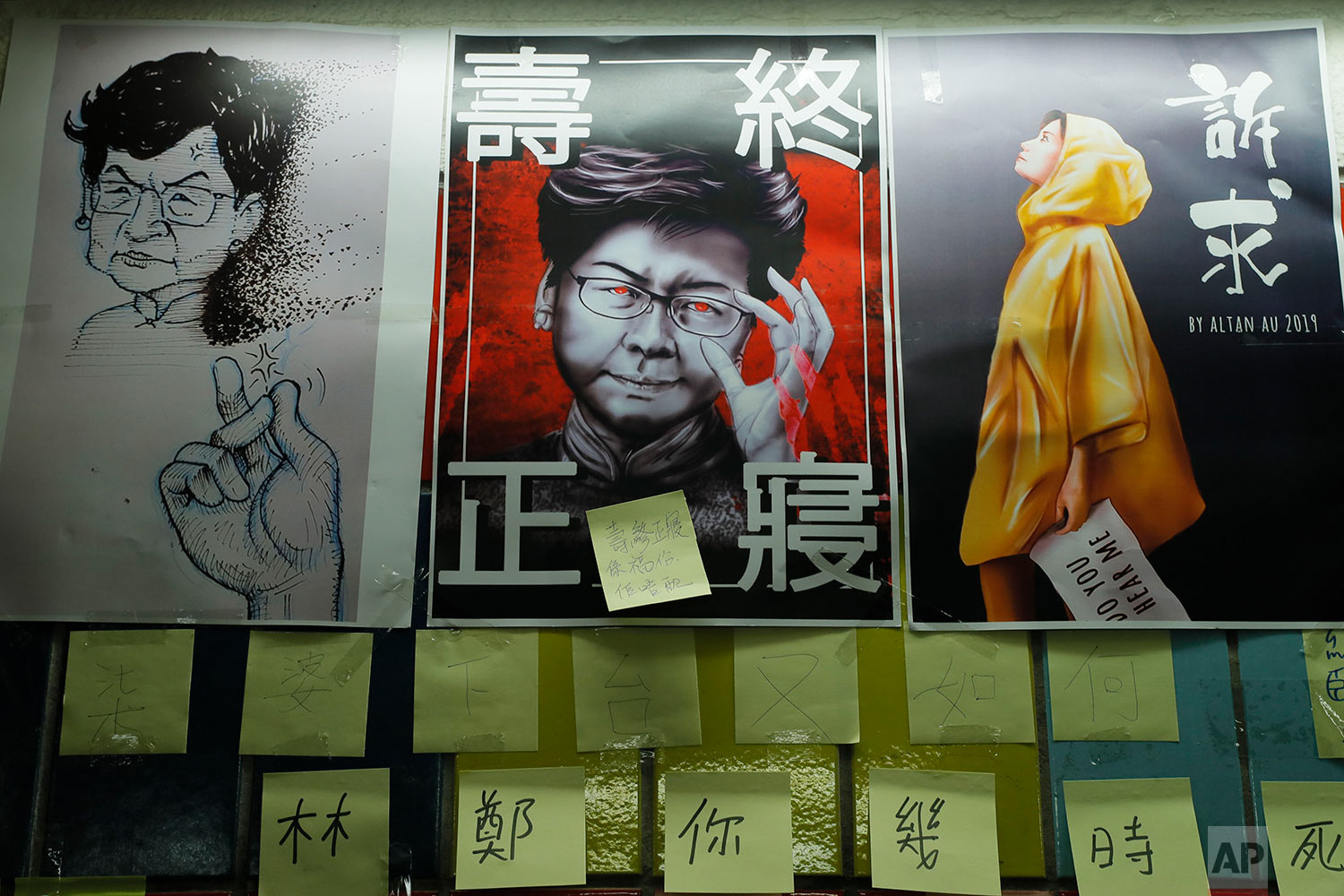 Post-it notes and a caricature of Hong Kong leader Carrie Lam are seen on their version Lennon Wall in Hong Kong, July 12, 2019. (AP Photo/Kin Cheung)