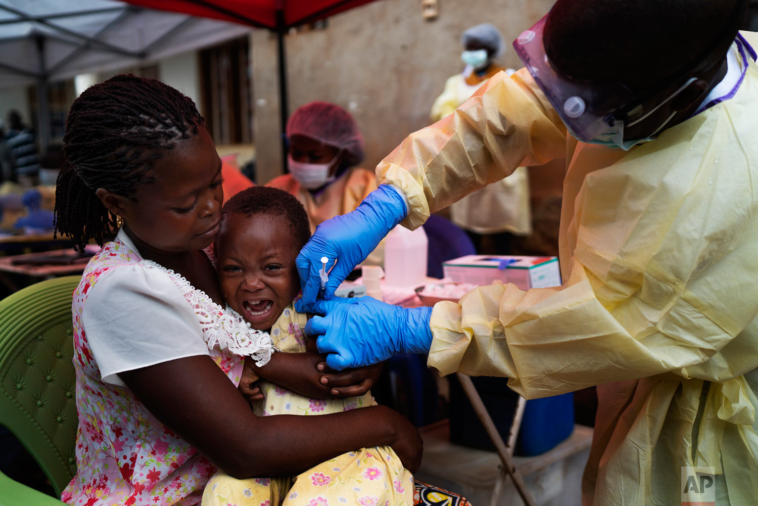 A child is vaccinated against Ebola in Beni, Congo on July 13 2019. (AP Photo/Jerome Delay)