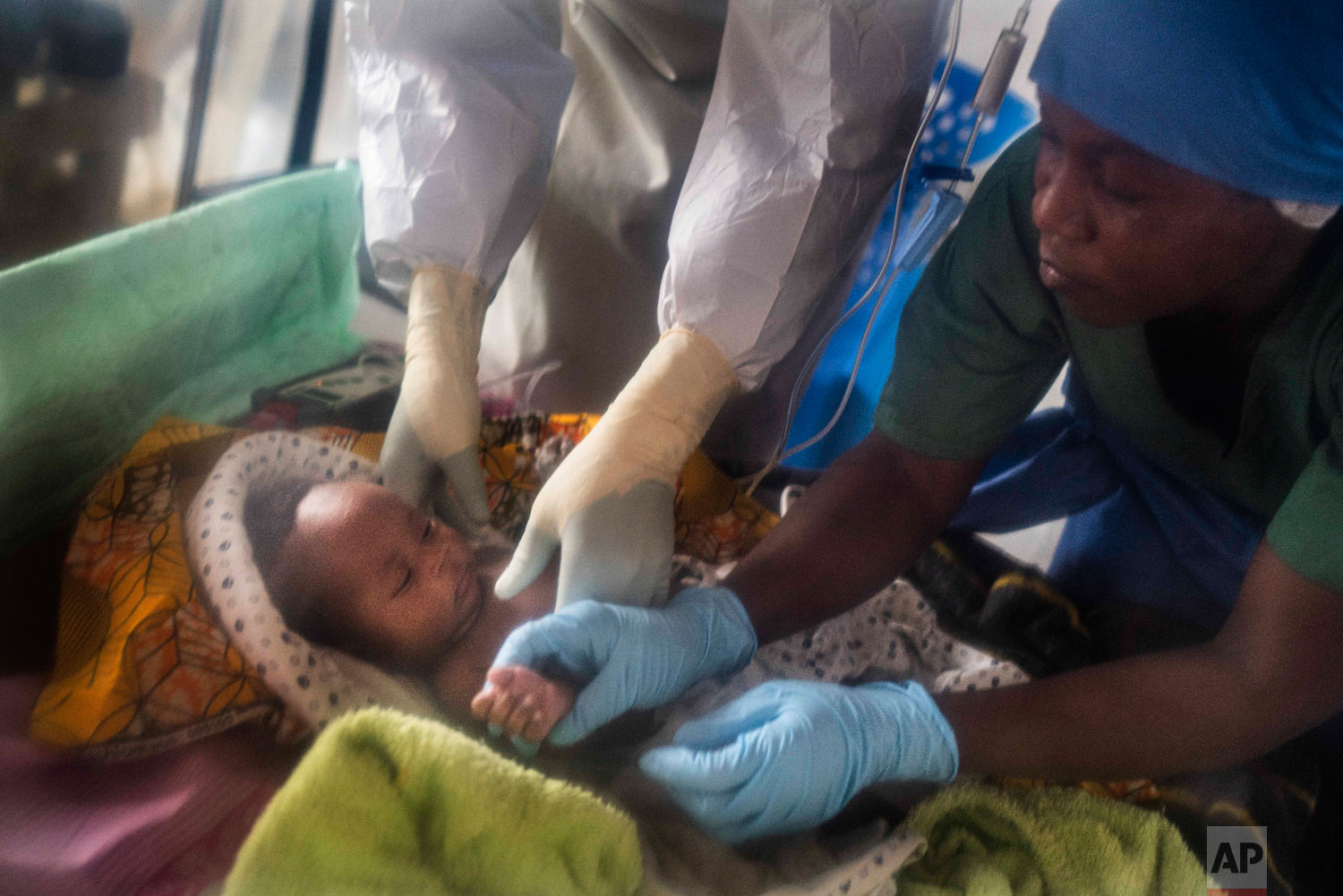 Health workers treat Amani Musanga, 6-weeks-old, at an Ebola treatment center in Beni, Congo, July 15 2019. (AP Photo/Jerome Delay)