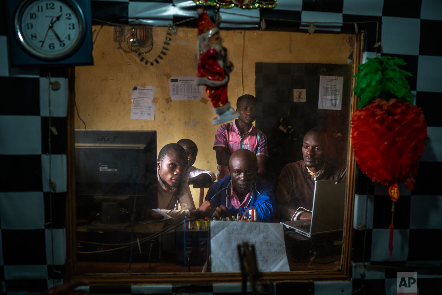 Congolese journalists broadcast an Ebola awareness program from a local radio station in Beni, Congo, July 13, 2019. (AP Photo/Jerome Delay)