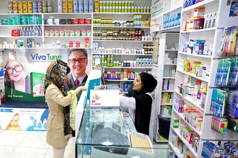 A pharmacist talks with a customer in a drugstore in downtown Tehran, Iran. (AP Photo/Ebrahim Noroozi)
