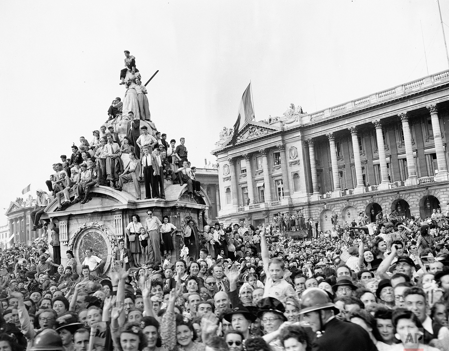 Crowds of Parisians, mad with joy, stage a huge celebration marking its liberation from Nazi control, and honoring Gen. Charles De Gaulle with a mammoth parade, Aug. 27, 1944. (AP Photo/Peter J. Carroll)
