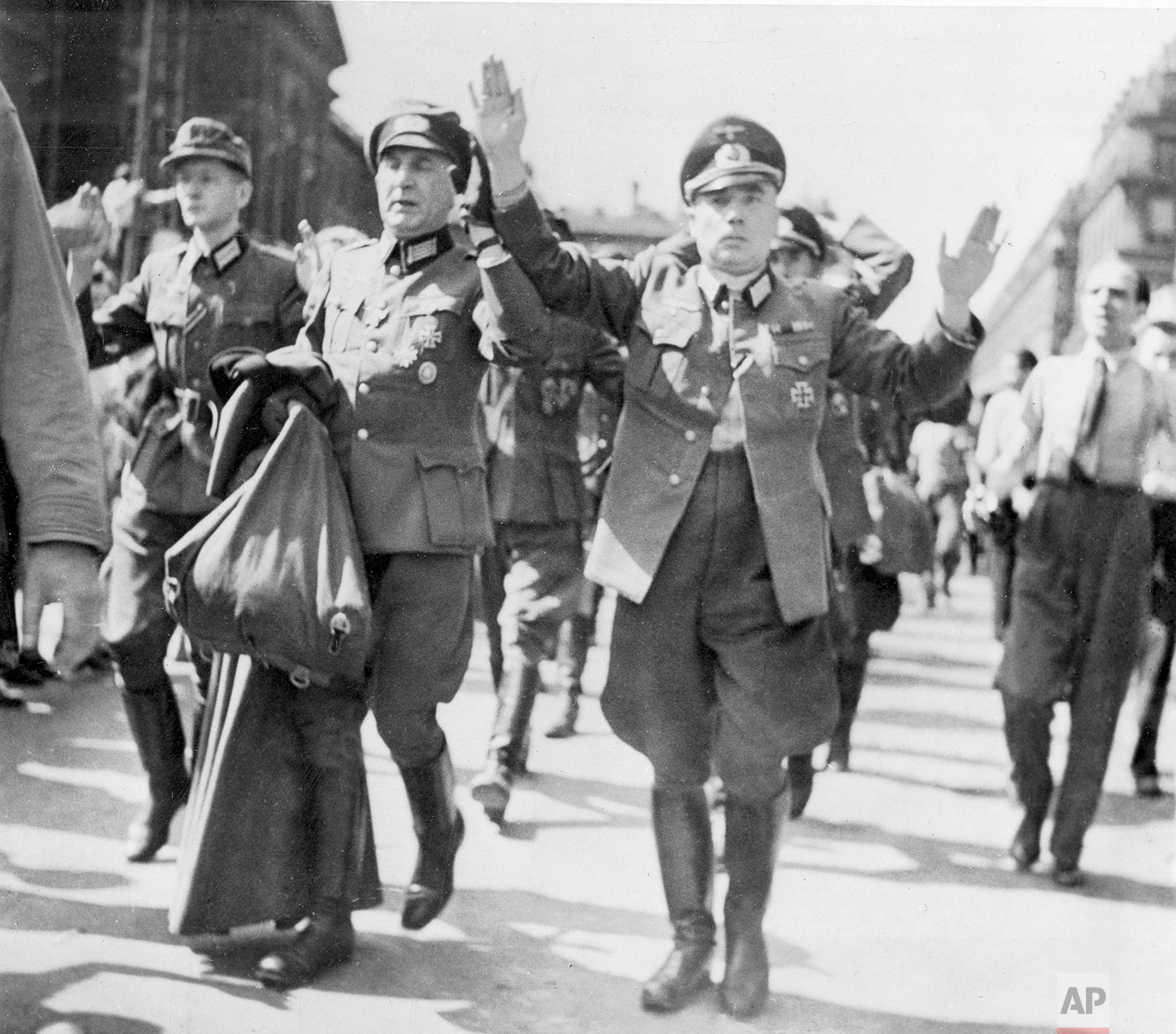 High German officers, captured by French patriot forces in Paris, are marched through the streets of the French capital with their hands in the air, during the freeing of the city, Aug. 28, 1944. This is one of a series of the first originals from Paris. (AP Photo)