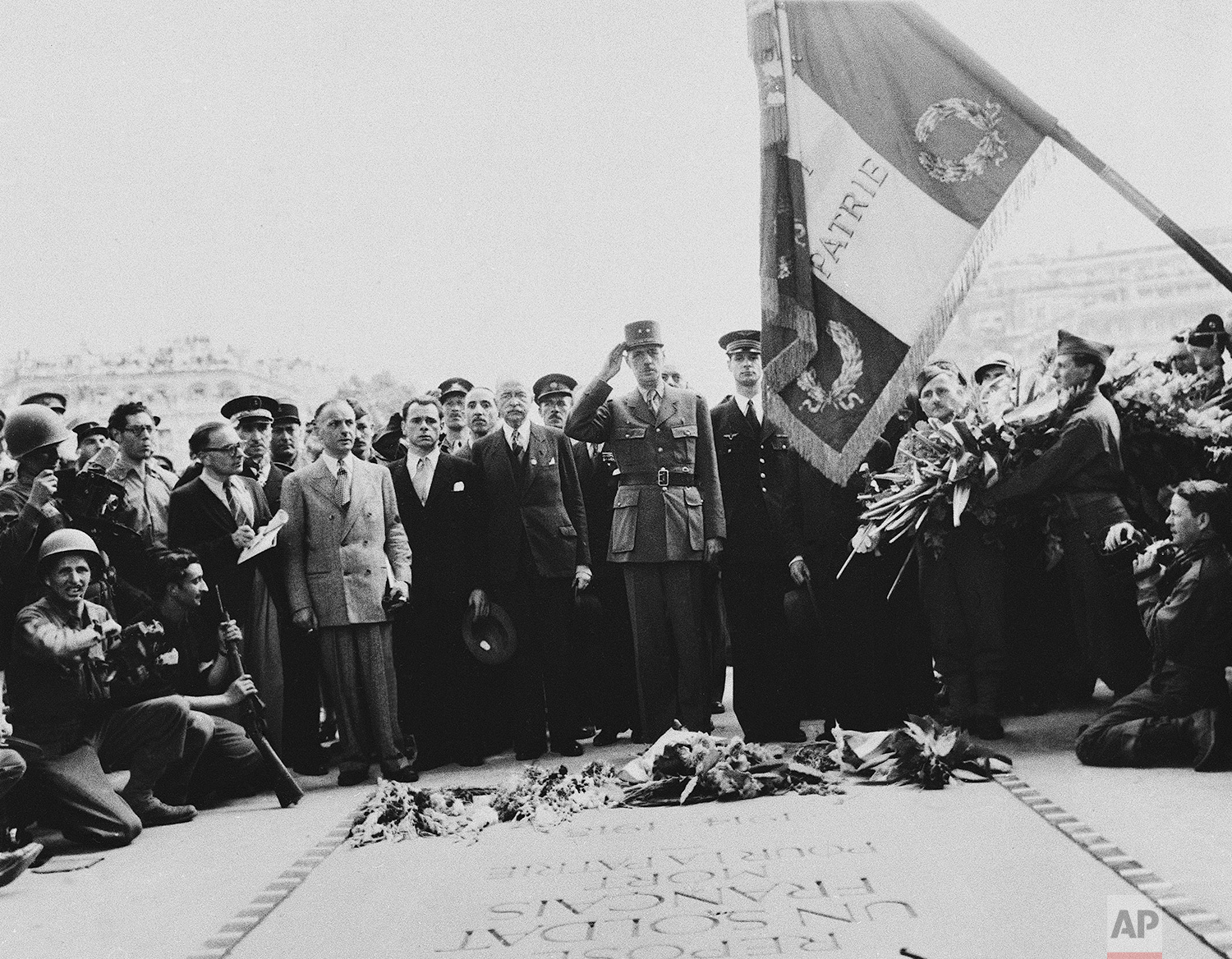 General Charles De Gaulle salutes the Tricolor after placing his wreath on the Tomb of the French Unknown Soldier of the last war, at the Arc de Triomphe in the French capital in Paris on August 28, 1944. (AP Photo/Andrew Lopez)