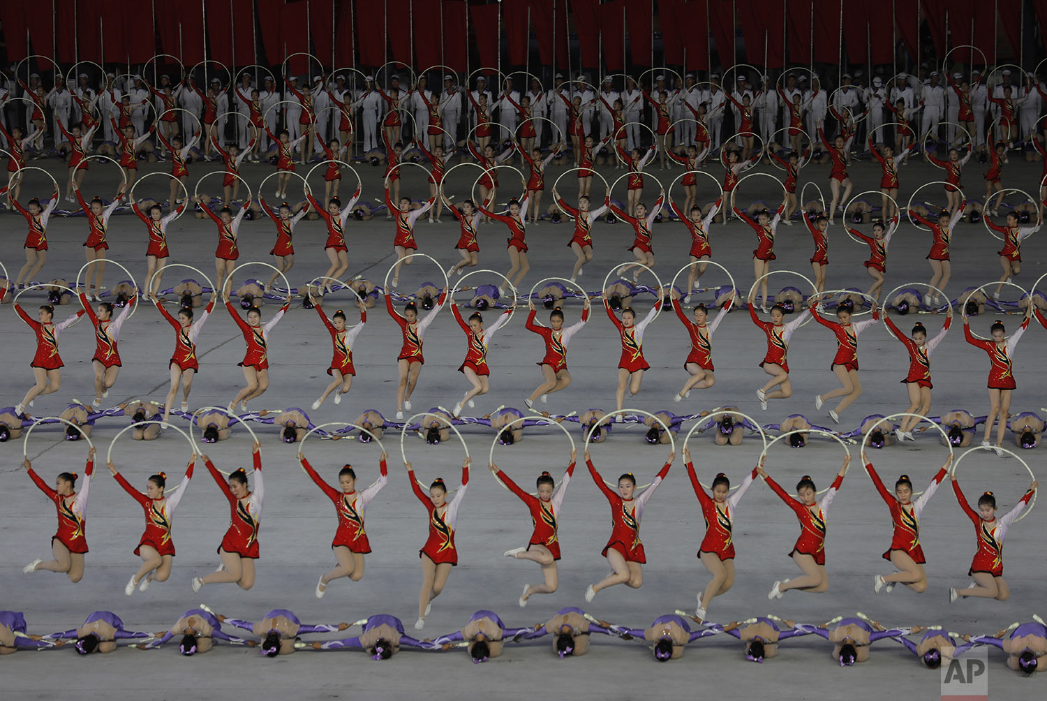 """North Koreans perform during a mass game performance of """"The Land of the People"""" at the May Day Stadium in Pyongyang, North Korea, Tuesday, July 16, 2019. (AP Photo/Vincent Yu)"""