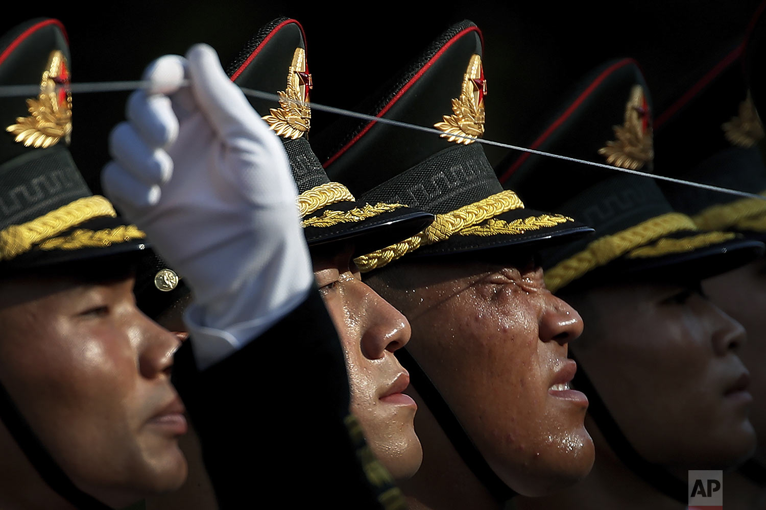 A member of an honor guard reacts as he and his comrades prepare for a welcome ceremony for visiting Colombia's President Ivan Duque, at the Great Hall of the People in Beijing, Wednesday, July 31, 2019. (AP Photo/Andy Wong)