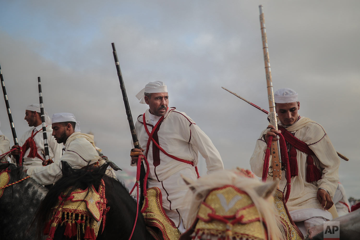 A troupe reacts after finishing a run during Tabourida, a traditional horse riding show also known as Fantasia, in the coastal town of El Jadida, Morocco, July 25, 2019. (AP Photo/Mosa'ab Elshamy)