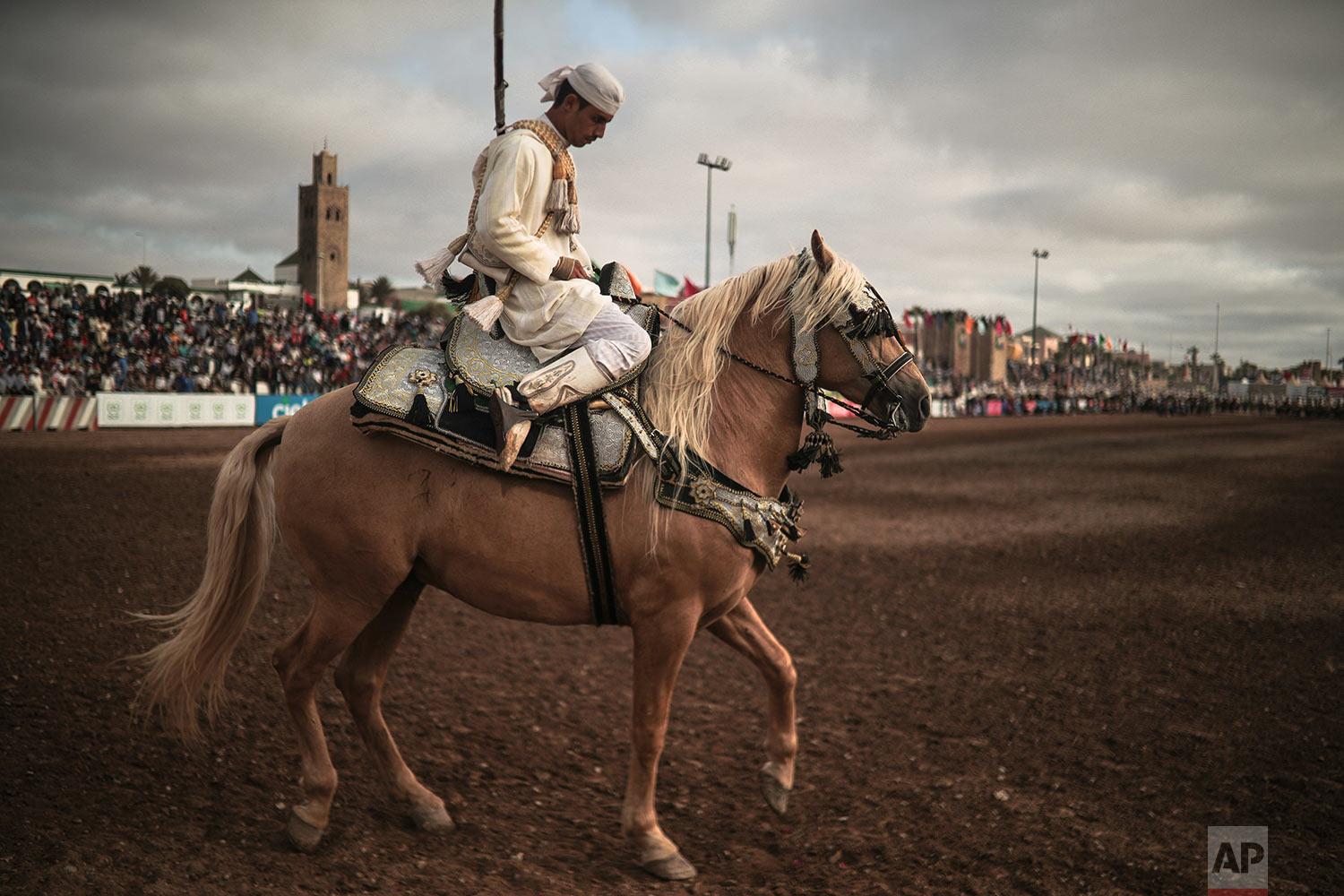 A horse rider prepares to exit after his troupe took part in Tabourida, a traditional horse riding show also known as Fantasia, in the coastal town of El Jadida, Morocco, July 25, 2019. (AP Photo/Mosa'ab Elshamy)