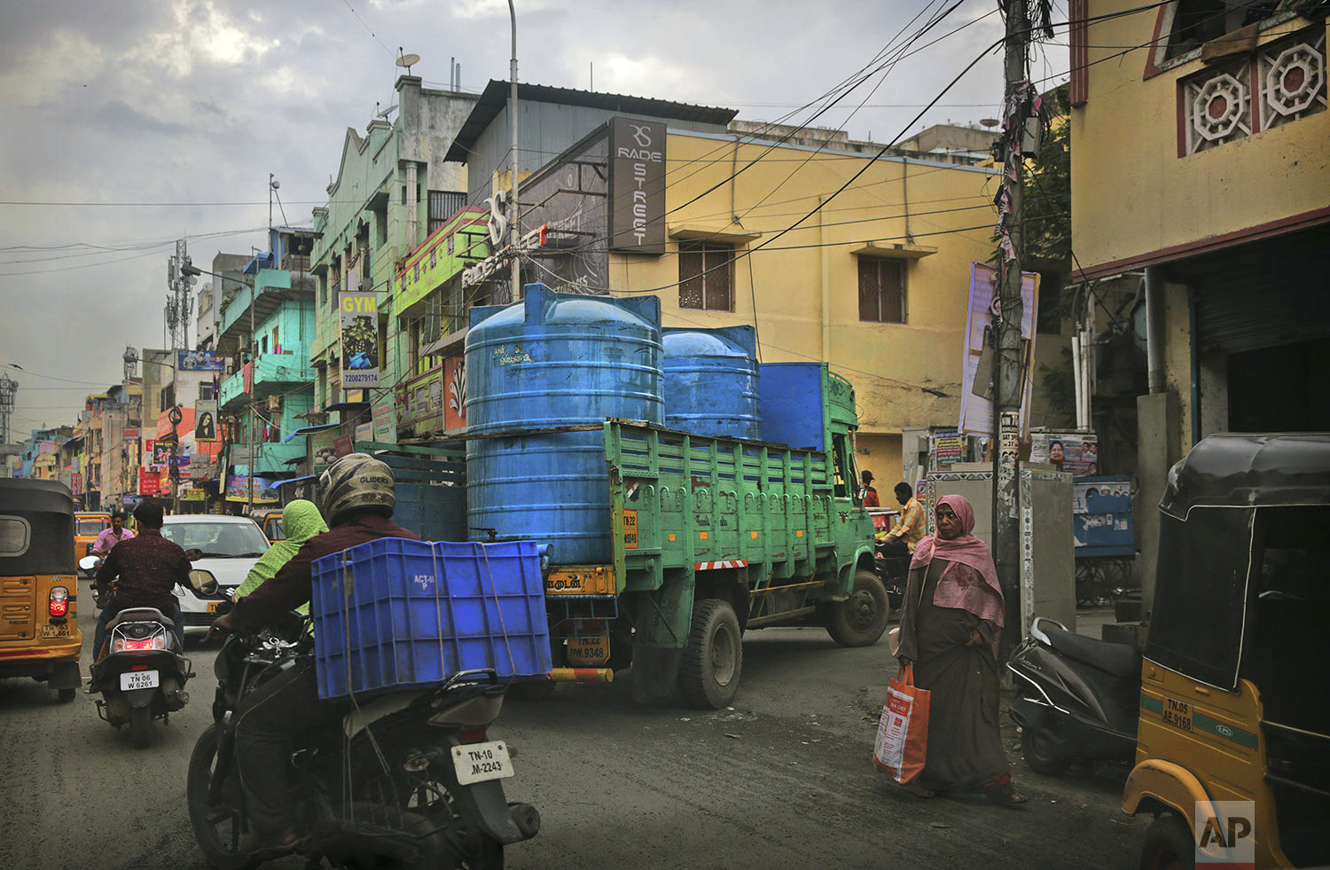 A water truck carrying drinking water arrives in a locality in Chennai in Southern Indian state of Tamil Nadu, Thursday, July 18, 2019. (AP Photo/Manish Swarup)