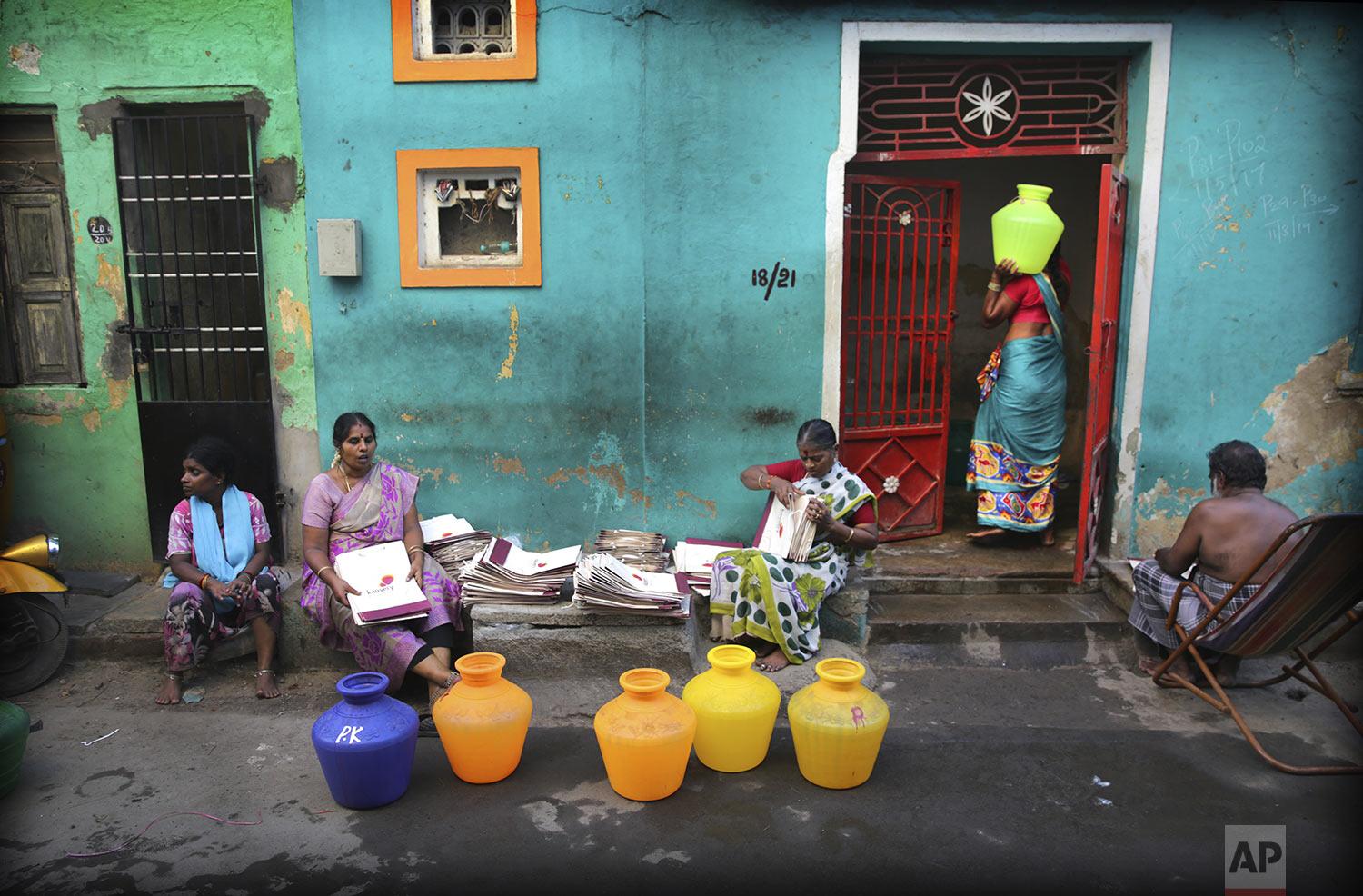 Residents fill drinking water from a water truck in Chennai in Southern Indian state of Tamil Nadu, Monday, July 15, 2019. (AP Photo/Manish Swarup)