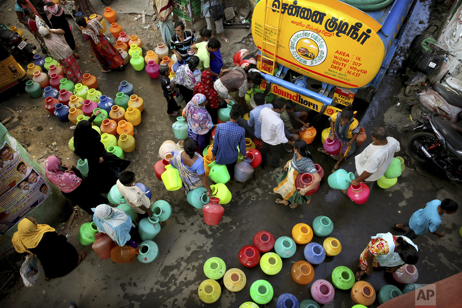 Residents fill drinking water from a truck in Chennai in Southern Indian state of Tamil Nadu, Monday, July 15, 2019.. (AP Photo/Manish Swarup)