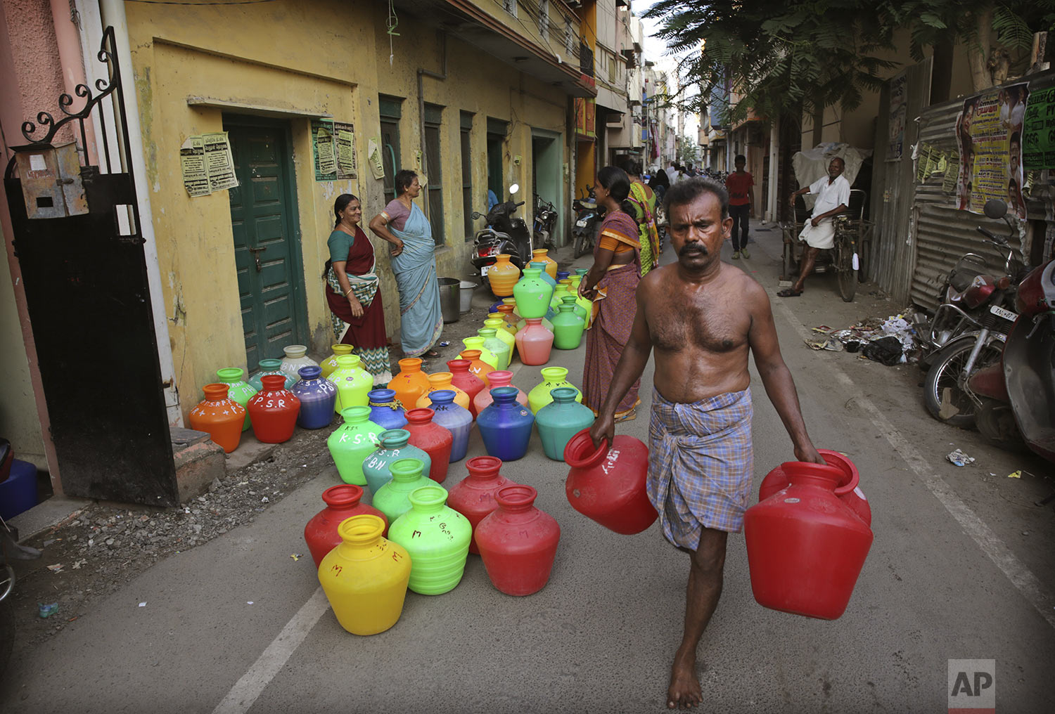 Residents wait for water trucks to arrive in Chennai in Southern Indian state of Tamil Nadu, Monday, July 15, 2019. (AP Photo/Manish Swarup)