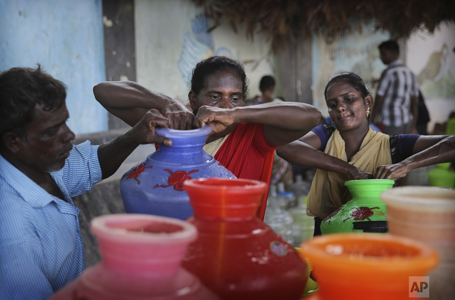 People load drinking water on to their hand cart in Chennai in Southern Indian state of Tamil Nadu, Monday, July 15, 2019. (AP Photo/Manish Swarup)
