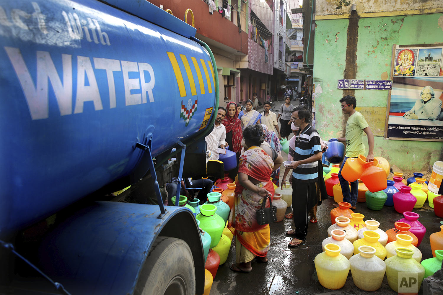 People fill drinking water from a water tanker truck in Chennai in Southern Indian state of Tamil Nadu, Monday, July 15, 2019. (AP Photo/Manish Swarup)