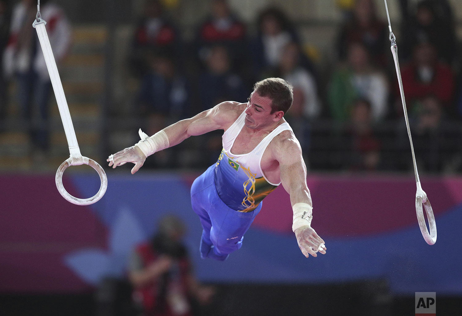 Arthur Zanetti of Brazil performs on the rings during the men's gymnastics qualification and team final at the Pan American Games in Lima, Peru, Sunday, July 28, 2019. (AP Photo/Martin Mejia)