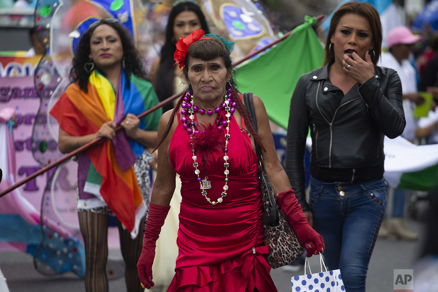 Revelers take part in the annual Gay Pride parade in Guatemala City's historical center, July 20, 2019. (AP Photo/Moises Castillo)