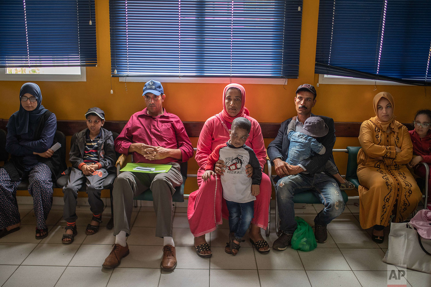 Families wait alongside their children affected by a rare disorder called xeroderma pigmentosum, or XP, inside a hospital in Casablanca, Morocco, July 24, 2019. (AP Photo/Mosa'ab Elshamy)