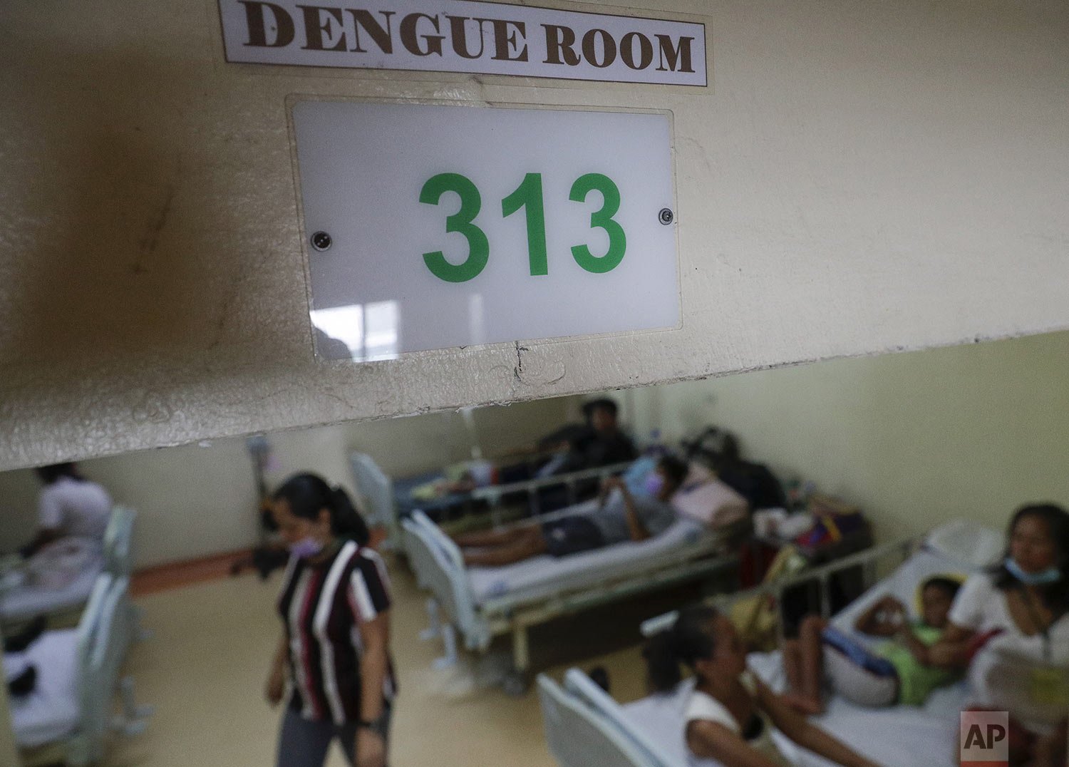 Dengue patients and relatives stay at the dengue room inside the San Lazaro government hospital in Manila, Philippines on Wednesday, Aug. 7, 2019. (AP Photo/Aaron Favila)