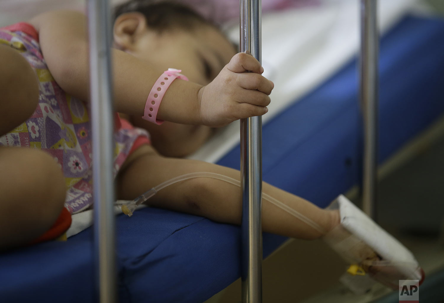 A young dengue patient rests inside a room at the San Lazaro government hospital in Manila, Philippines on Wednesday, Aug. 7, 2019. (AP Photo/Aaron Favila)