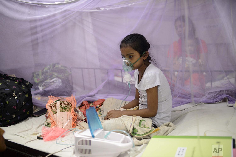 A child receives treatment for dengue at Dhaka Shishu Hospital in Dhaka, Bangladesh, Wednesday, July 31, 2019. (AP Photo/Mahmud Hossain Opu)
