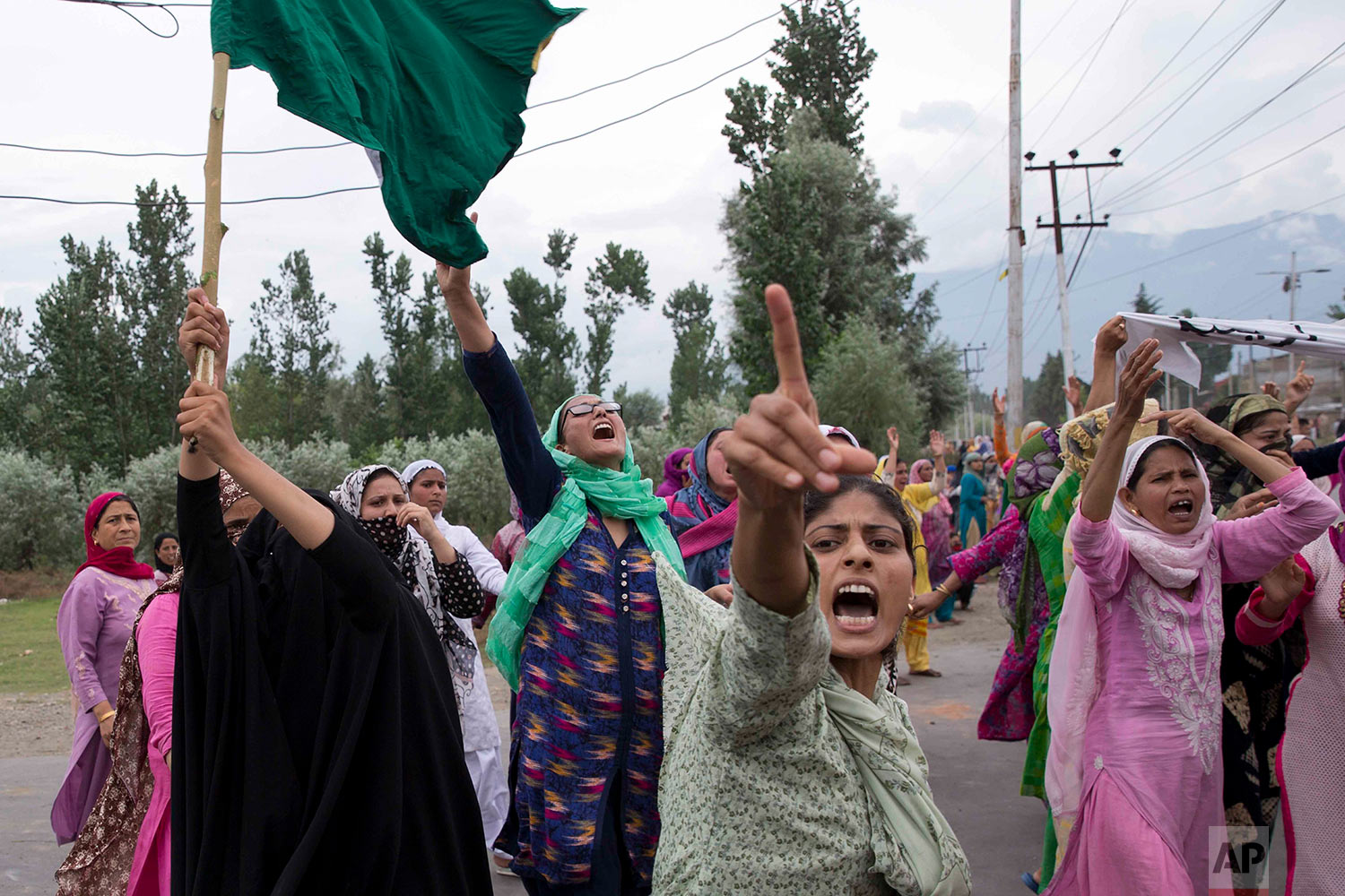 Women shout slogans and march on a street after Friday prayers in Srinagar, Indian controlled Kashmir, Friday, Aug. 9, 2019. A strict curfew in Indian-administered Kashmir in effect for a fifth day was eased Friday to allow residents to pray at mosques, officials said, but some protests still broke out in the disputed region. The predominantly Muslim area has been under the unprecedented lockdown and near-total communications blackout to prevent unrest and protests after India's Hindu nationalist-led government said Monday it was revoking Kashmir's special constitutional status and downgrading its statehood. (AP Photo/ Dar Yasin)