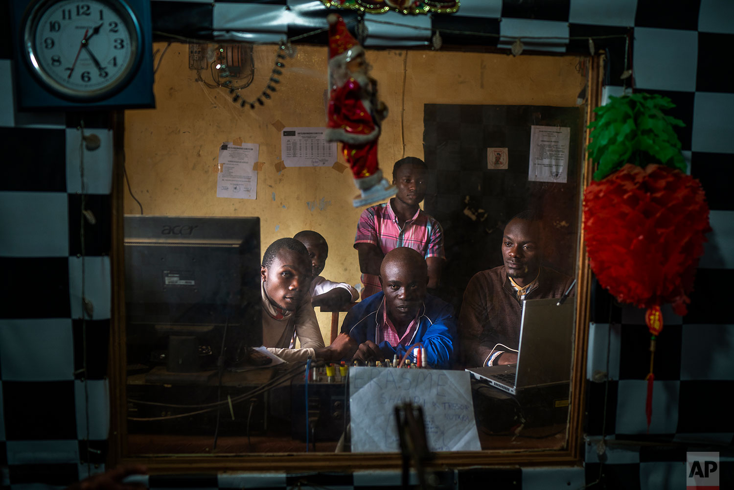In this July 13, 2019 photo, Congolese journalists broadcast an Ebola awareness program from a local radio station in Beni, Congo DRC. (AP Photo/Jerome Delay)